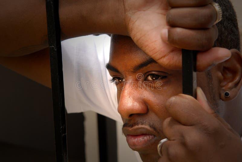 Gezicht van een boze Afrikaanse Amerikaanse mens stock afbeelding