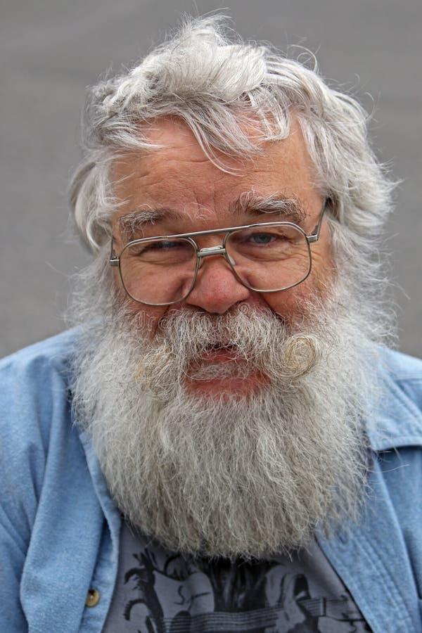 Gezicht van een hogere mens met baard stock foto's