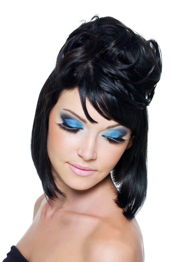 Gezicht van een mooie vrouw met blauwe samenstelling stock fotografie