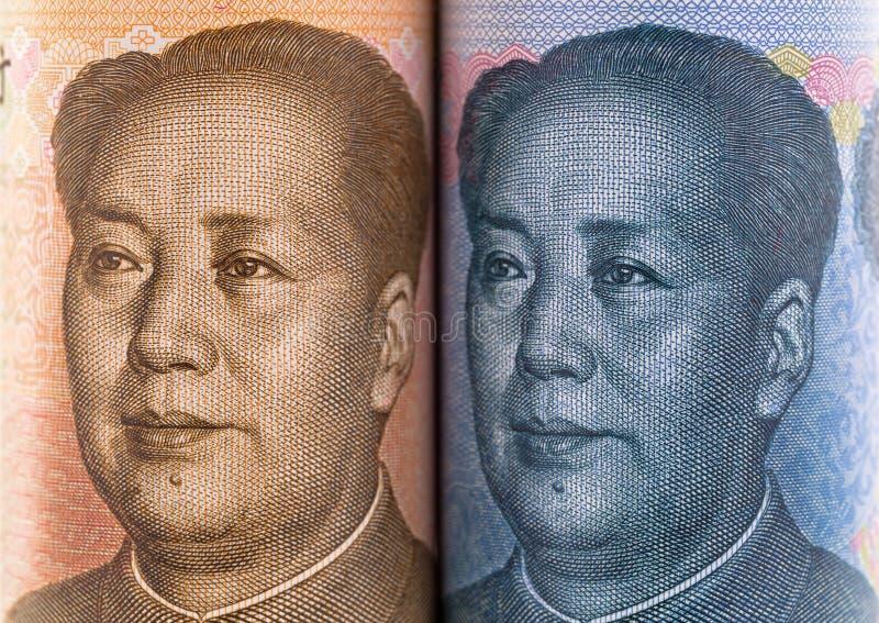 Gezichtsdeel van Chinese yuansbankbiljetten met gezicht van Mao tse-Tungboom stock foto's