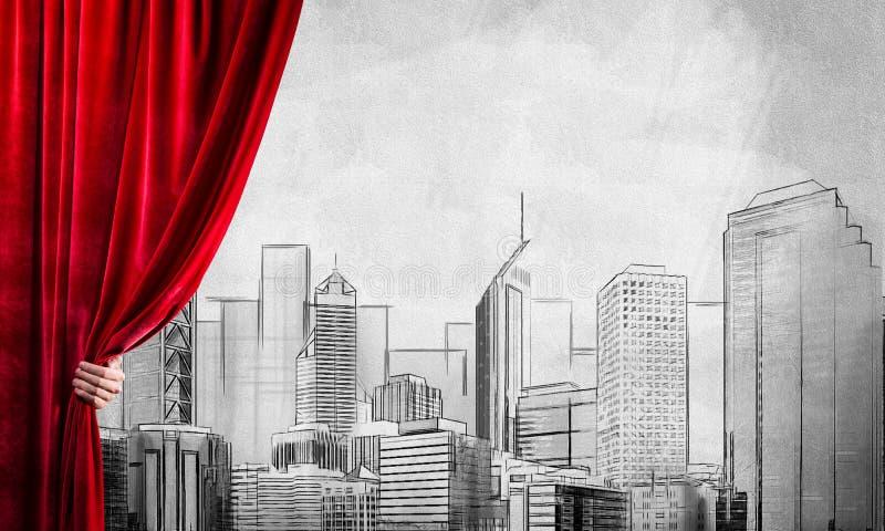 Gezogenes modernes Stadtbild hinter dem Drapierungsvorhang und -hand, die es öffnen stockfoto