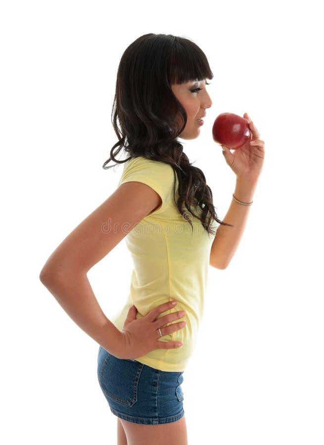 Gezond meisje dat fruit eet stock foto's