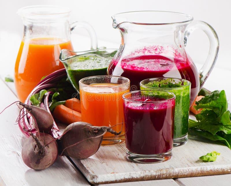 Gezond plantaardig smoothie en sap stock fotografie
