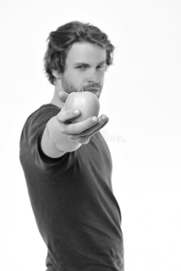 Gezond voeding en levensstijlconcept De mens met varkenshaar houdt appel Kerel in blauwe t-shirt stock foto's