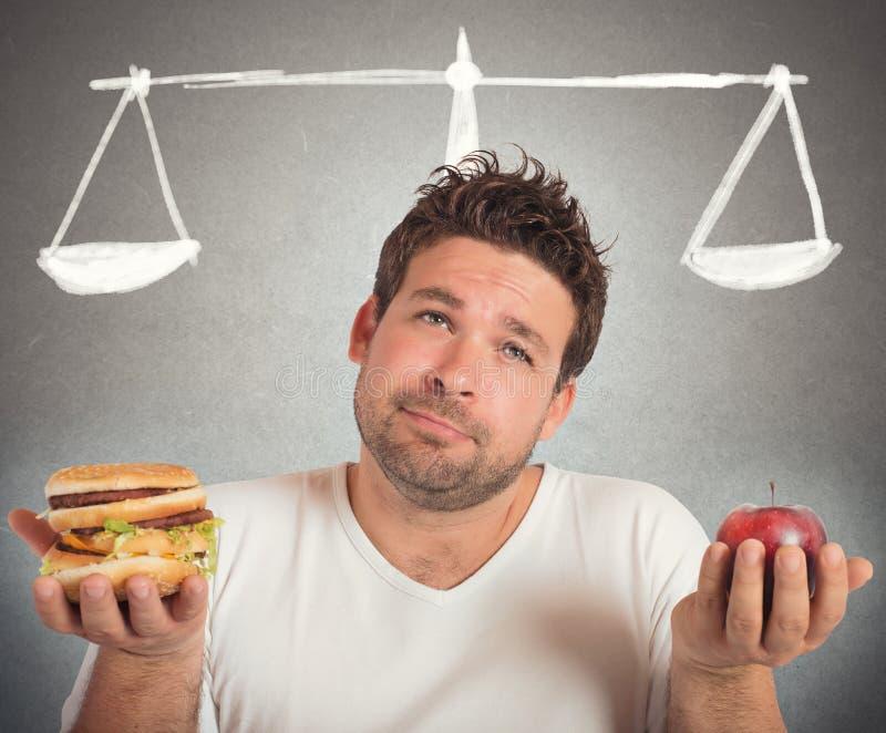 Gezond voedsel en ongezond stock foto's