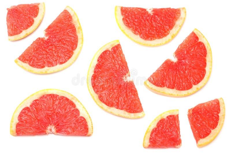 Gezond voedsel Gesneden die grapefruit op witte achtergrond wordt geïsoleerd Hoogste mening stock foto