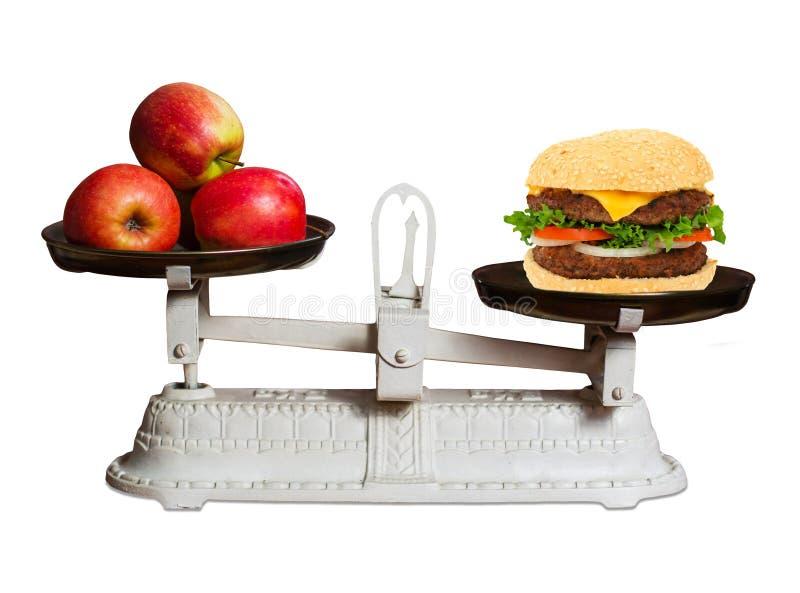 Gezond voedsel tegenover snel voedsel stock foto