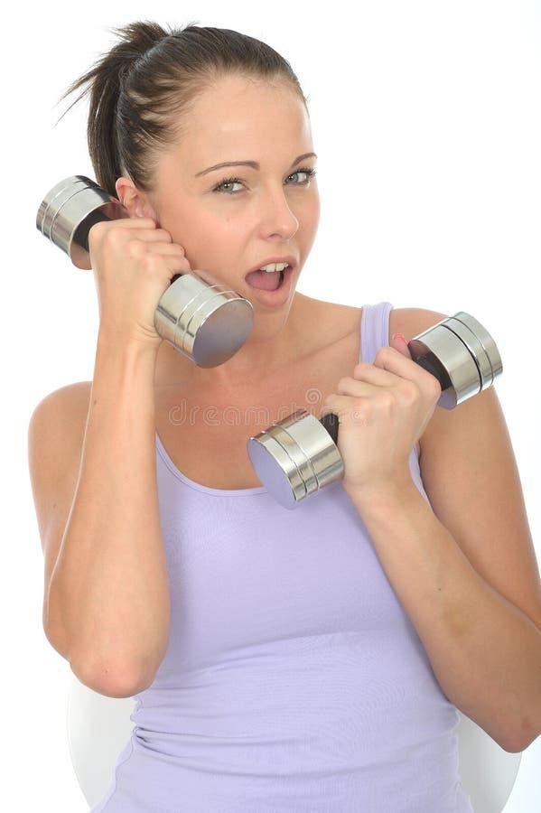 Gezonde Gekke Geschikte Jonge Vrouw die een Stom Klokgewicht gebruiken als Celtelefoon stock afbeeldingen