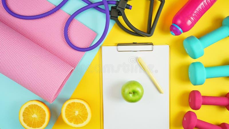 Gezondheid en geschiktheidsconcept op moderne kleurrijke achtergrond stock fotografie