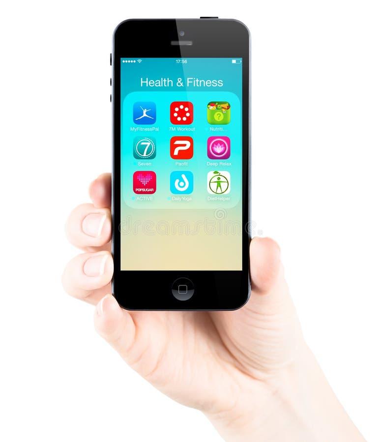 Gezondheid en geschiktheidstoepassingen op het iPhone5s scherm stock afbeelding