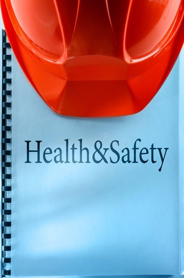 Gezondheid en veiligheid met helm stock afbeelding