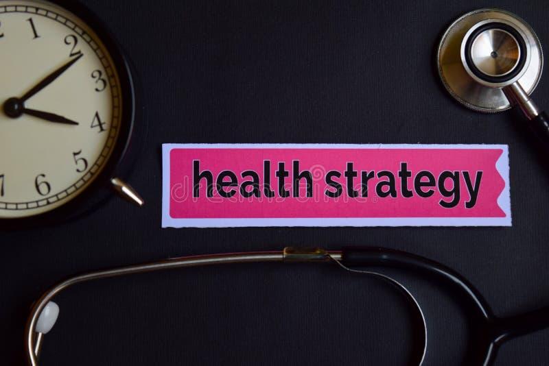 Gezondheidsstrategie op het drukdocument met de Inspiratie van het Gezondheidszorgconcept wekker, Zwarte stethoscoop royalty-vrije stock fotografie