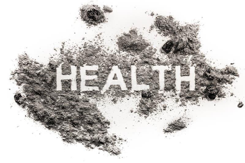 Gezondheidswoord in vuil als metafoor voor ziekte wordt geschreven die royalty-vrije stock afbeelding