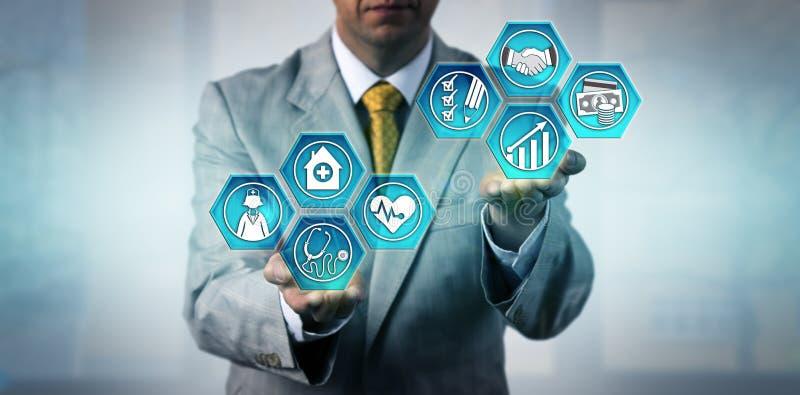 Gezondheidszorgmanager Budgeting For Improvement royalty-vrije stock afbeeldingen