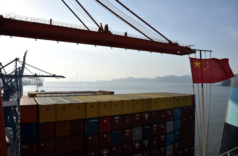Ggantry cranes loading containers on the cargo ship stock photo