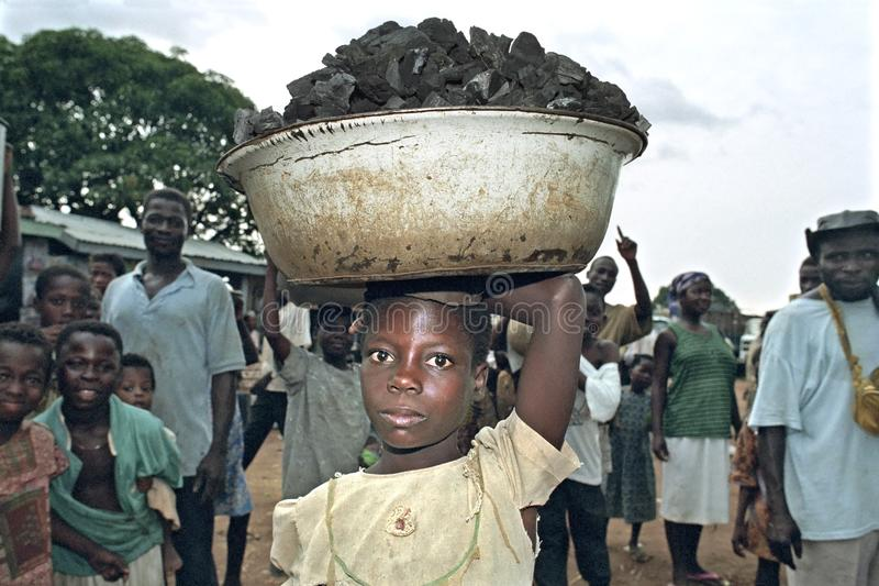 Child labor on the Ghanaian market of Abease royalty free stock image