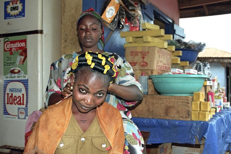 Ghanaian woman at barber shop and grocery store royalty free stock photo