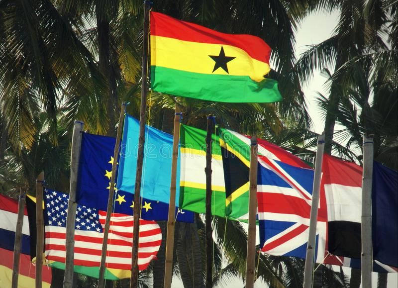 Ghanansk flagga bland internationella flaggor royaltyfri fotografi