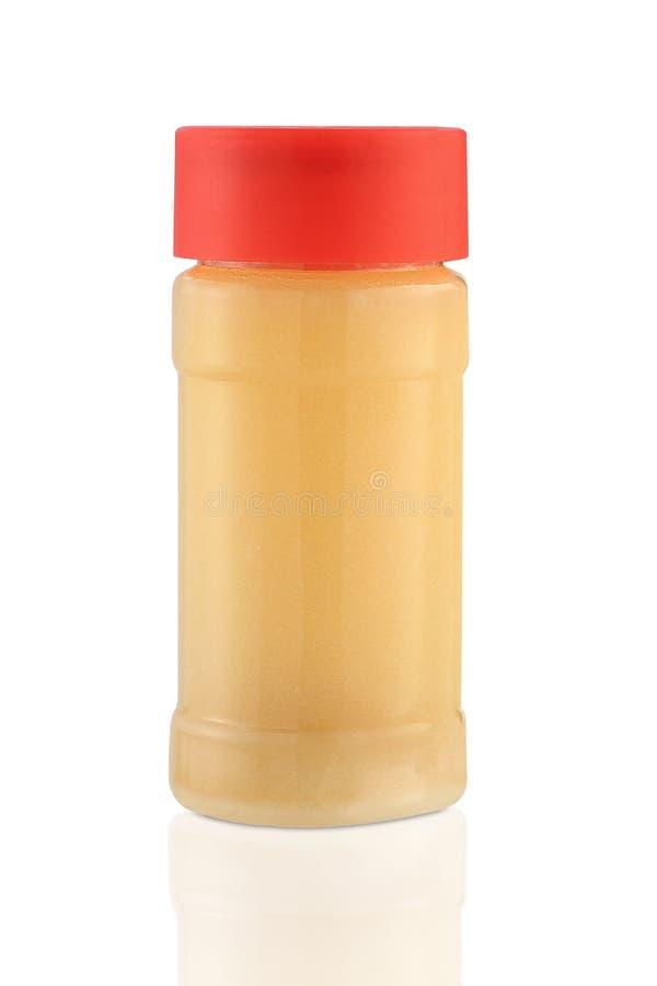 Ghee clarifié de beurre, d'isolement image stock