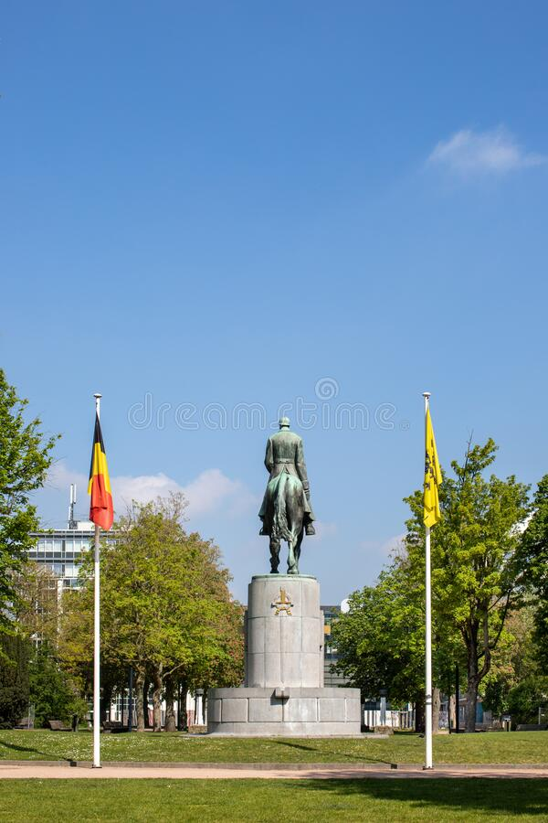 Ghent, Belgium - April 26, 2020: Statue of King Albert 1, photographed from behind in the King Albert Park or Zuidpark. royalty free stock image