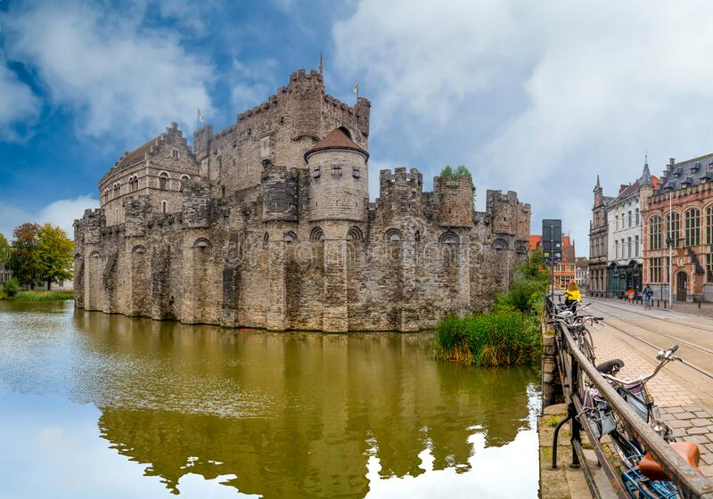 Ghent/Belgium - October 10, 2019: View from the river of the castle of Ghent in Belgium with blue sky and white clouds royalty free stock photo