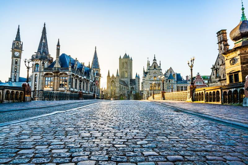 City landmarks skyline from St. Michael's Bridge at sunrise in Ghent, Belgium royalty free stock images