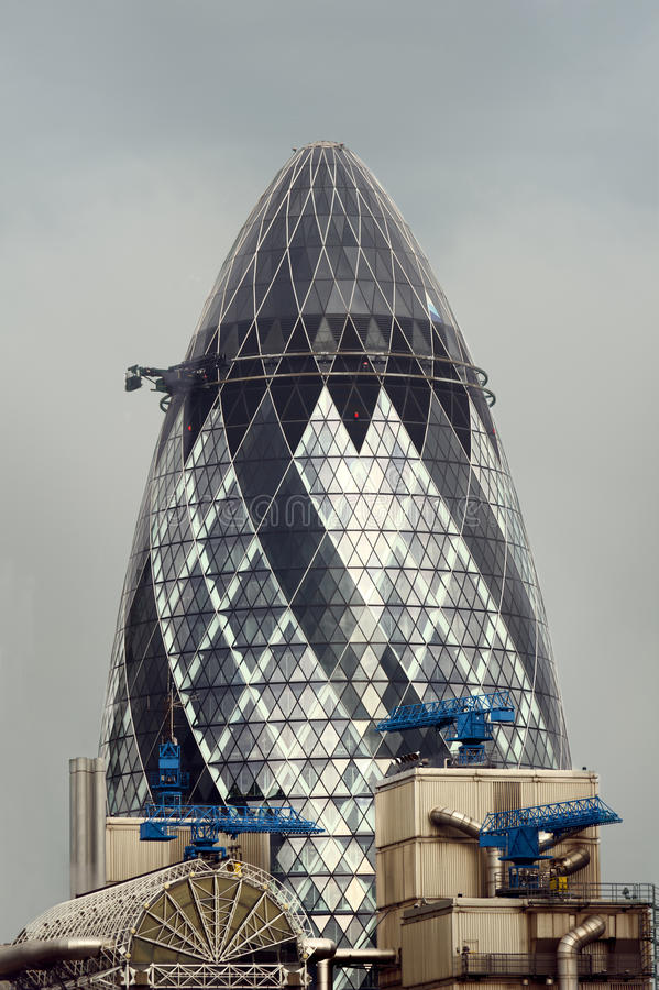 Gherkin, London. The Gherkin (also known as the Swiss RE tower) at 30 St Mary Axe street, city of London, as seen on a drab, cloudy, day royalty free stock photos