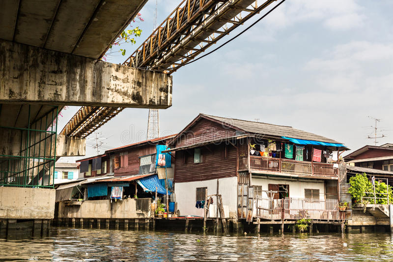 Ghetto in Thailand. Ghetto on dirty canal in Thailand royalty free stock photos