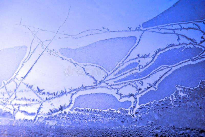 Ghiaccio sul vetro di finestra, primo piano di struttura dello sfondo naturale fotografia stock libera da diritti