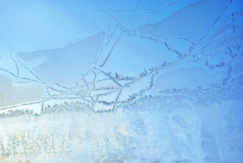 Ghiaccio sul vetro di finestra, primo piano di struttura dello sfondo naturale immagini stock libere da diritti