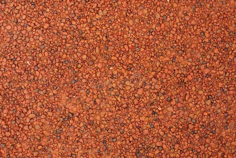 Ghiaia rossa della laterite per fondo fotografia stock libera da diritti