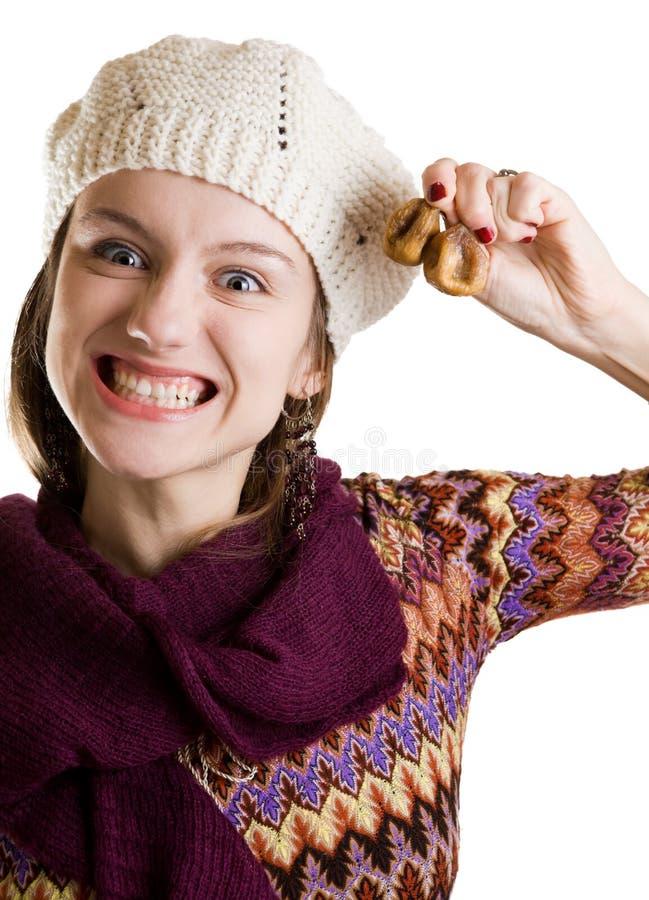 Ghignare ragazza con i fichi in sua mano fotografie stock libere da diritti