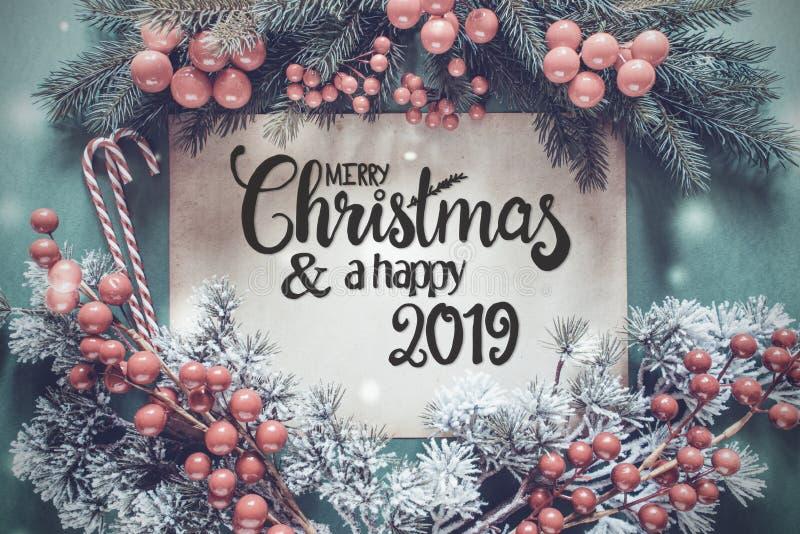 Ghirlanda di Chrismtas, Buon Natale di calligrafia e un 2019 felice fotografie stock