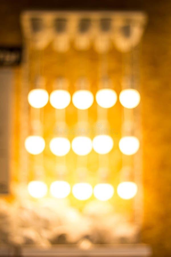 Ghirlanda vaga Bokeh della sfuocatura della luce notturna della città, fondo defocused immagini stock libere da diritti