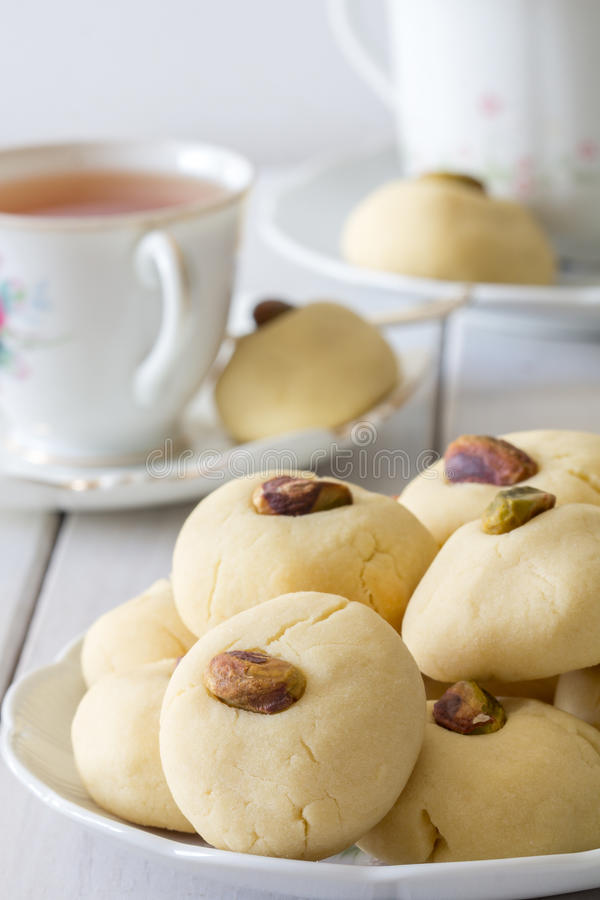 Ghorayeba Egyptian Butter Cookies with Tea Vertical stock photo