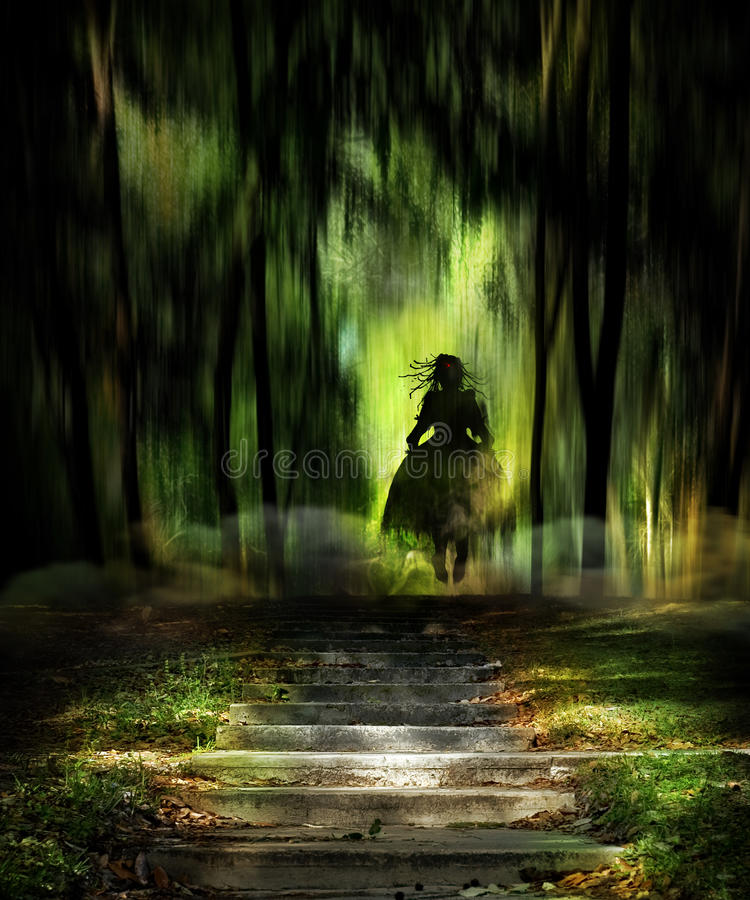 Ghost. A silhouette of a young female ghost hovering at the entrance to an eerily lit forest. Halloween concept