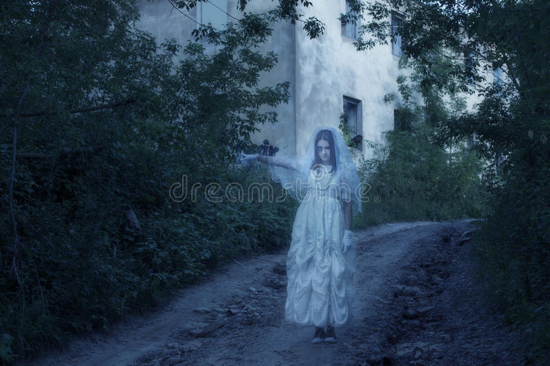 Ghost on background old house royalty free stock photo