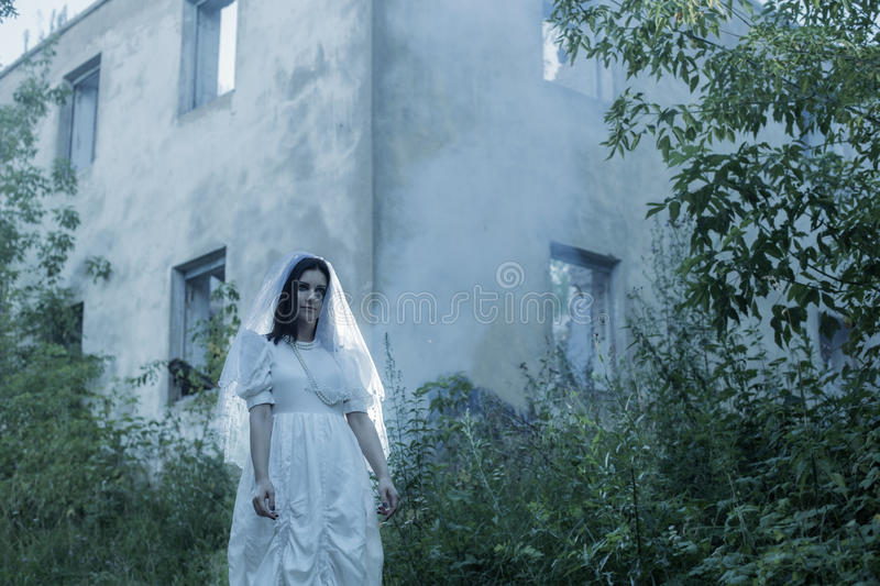 Ghost on background old house royalty free stock photos