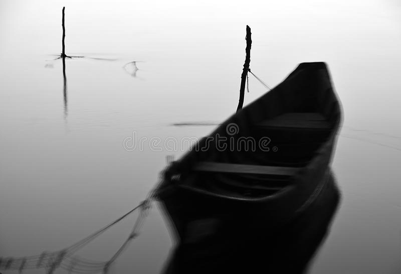 Ghost Boat. Black and white monochrome with long exposure at sunset stock photography