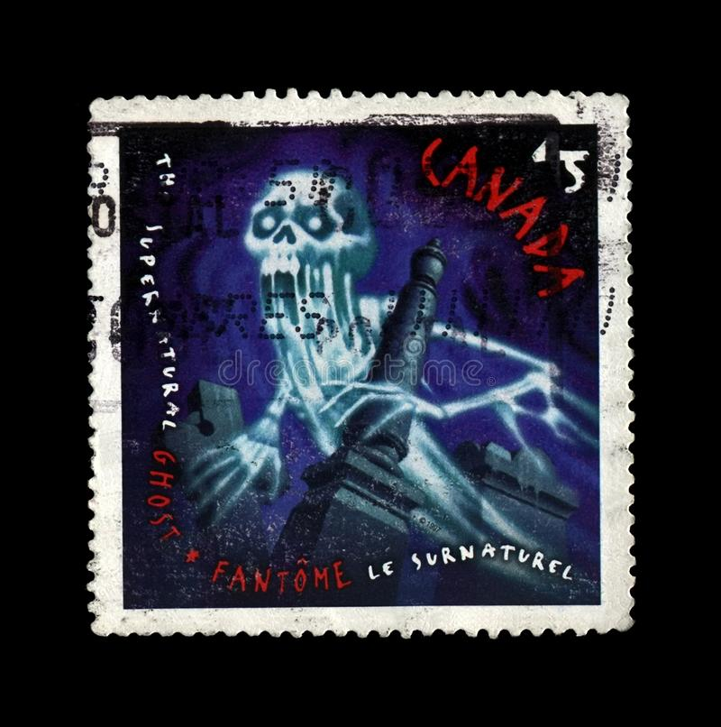 Ghost, Canada, circa 1997,. CANADA - CIRCA 1997: vintage canceled stamp printed in Canada shows Ghost, circa 1997. vintage postal stamp isolated on black stock photo