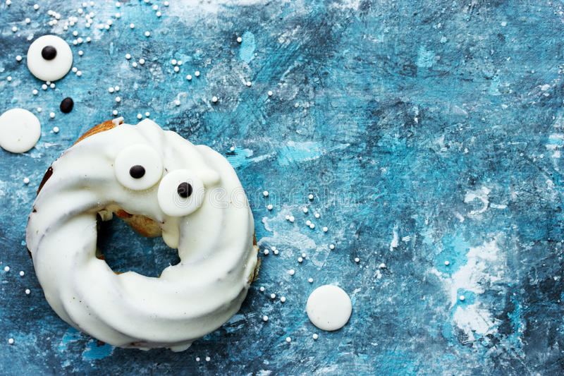 Ghost chocolate donut with eyes, Happy Halloween background. Ghost chocolate donut with eyes, Happy Halloween food background stock photo