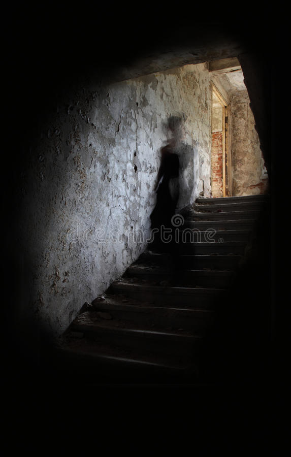 Free Ghost Figure On Stairs Royalty Free Stock Photography - 21253937