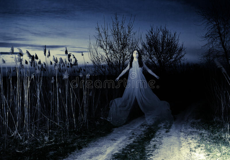 The Ghost flies along the road. Ghost on a rural road. Evening stock photo