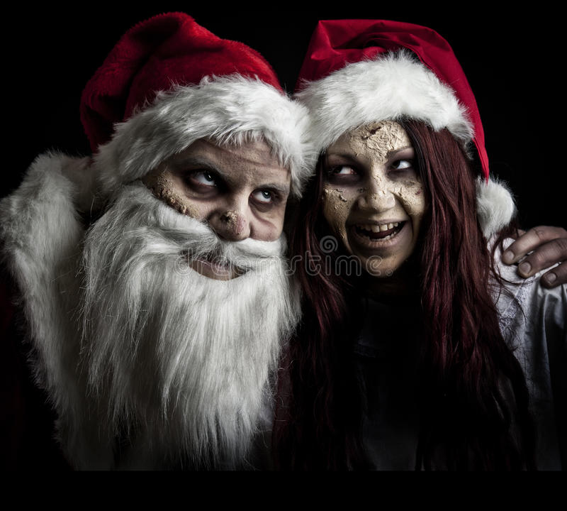 Ghost girl. A scary ghost santa and helper royalty free stock photography