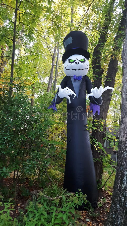 Ghost groom in woods for Halloween. Ghost male tuxedo top hat woods Halloween portrait one vertical royalty free stock photo
