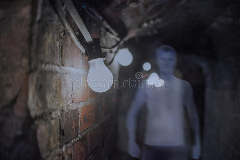 Ghost in Haunted House, Mysterious Man, close up on bulb royalty free stock photography
