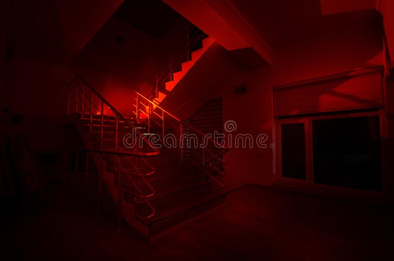 Ghost in Haunted House at stairs, Mysterious silhouette of ghost man with light at stairs, Horror scene of scary ghost spooky llig. Hts . Scary hall. Halloween stock photography