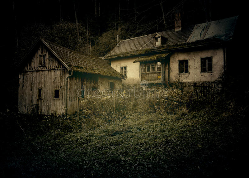 Ghost house. Abandoned ghost house with dark effect in the woods royalty free stock photos