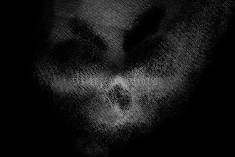 Ghost mask with dark. Ghost mask with background of horror in the dark stock images