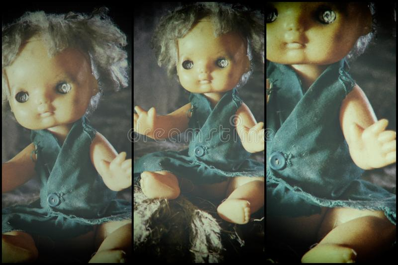 Scary horror plastic doll without eyes. Ghost mystic doll smiling. Scary horror plastic doll without eyes stock image
